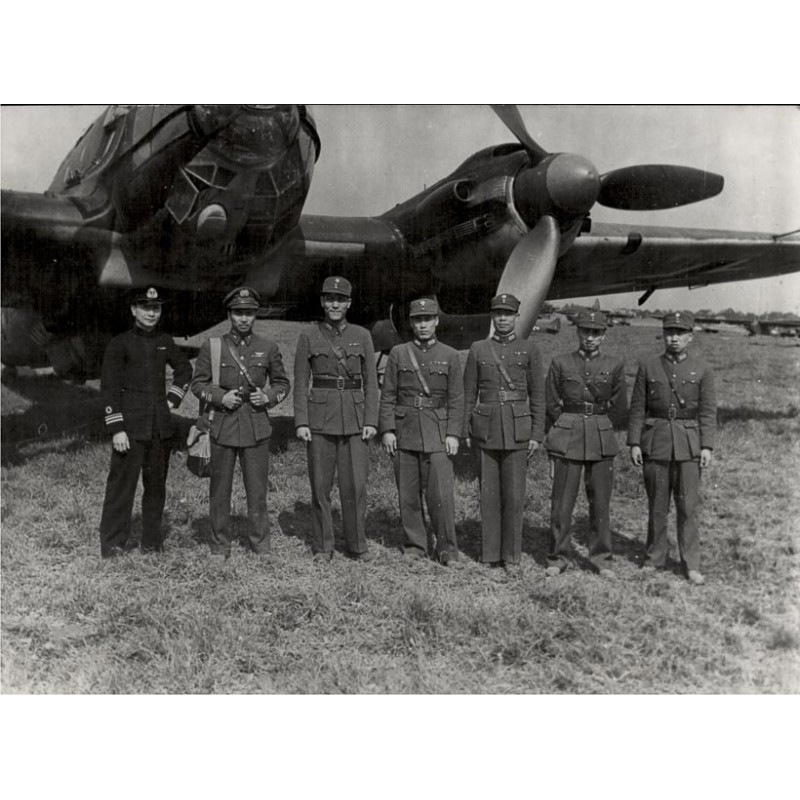 Officers from Chinese Army of Chiang Kai-shek in front of an German Heinkell warplane (1945)