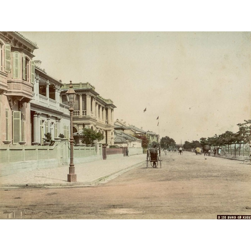 Japan - Anonymous: Bund of Kobe. Street scenery. Handcoloured albumen print (approx. 1885).