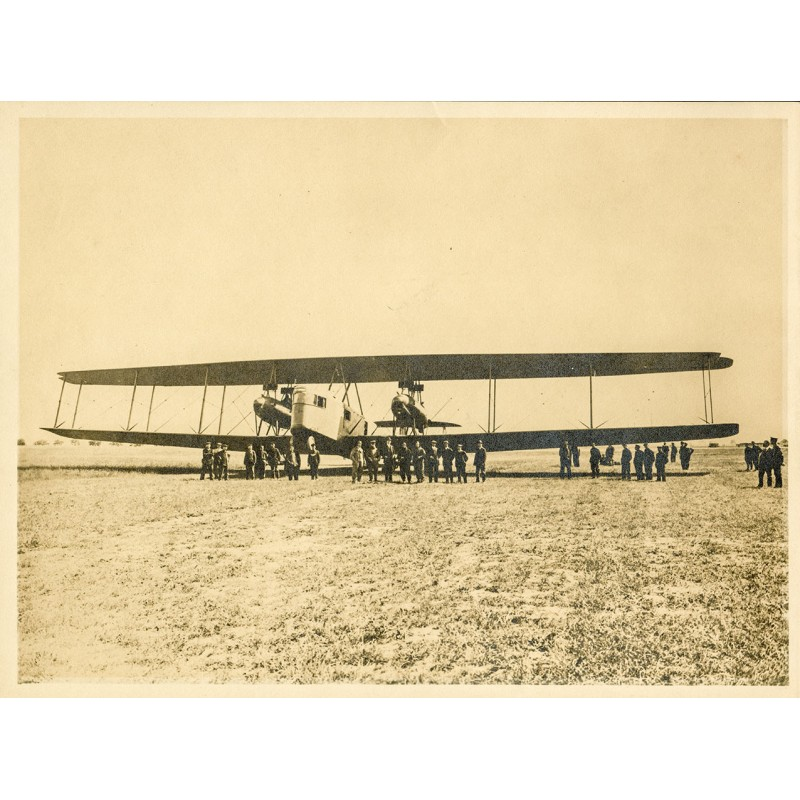 Ernormous biplane with crew and vistiors. Original photography - brown tinted silver gelatine print (1920th).