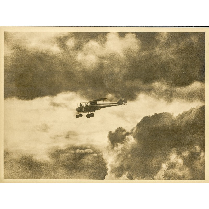 Aviation and photo art: Anonym: Biplane in the clouds (approx. 1920). Original photography.