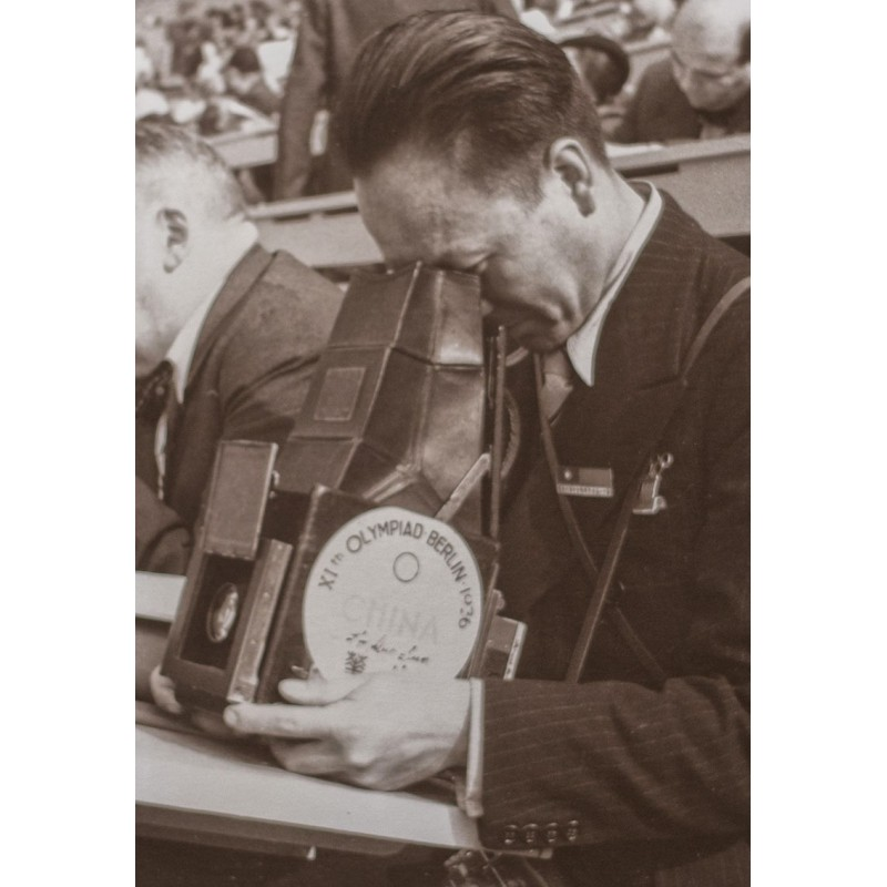 Joseph Schorer: Olympic Games Berlin 1936: Photographer with large format camera with olympic label. Original photography.